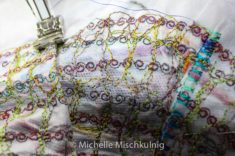 Sewing over the tucks/darts with a decorative stitch.